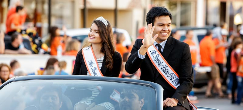 Mr and Mrs Hispanic OSU at Homecoming parade