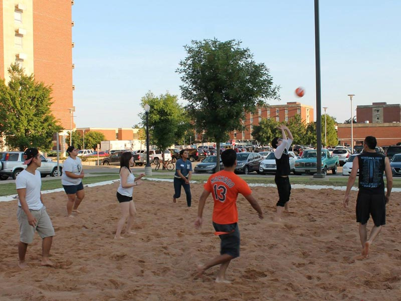 Students playing volleyball at student org cookout
